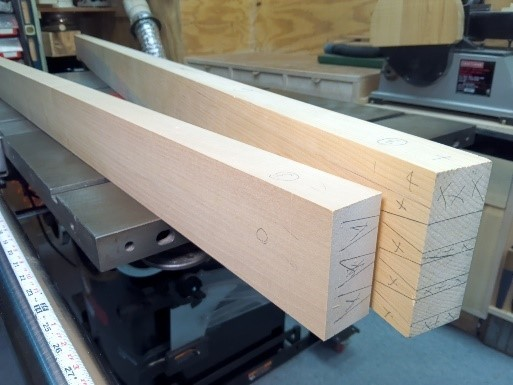 Bed frame rails marked out for half blind dovetail joinery