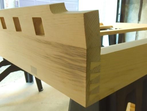 Planed and sanded bed frame half blind dovetail joint corner
