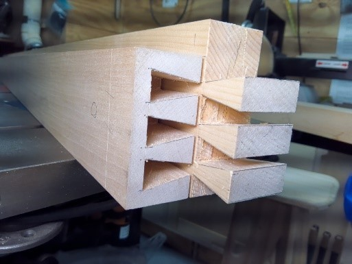 Bed frame rails cut and waste removed for half blind dovetail joiner